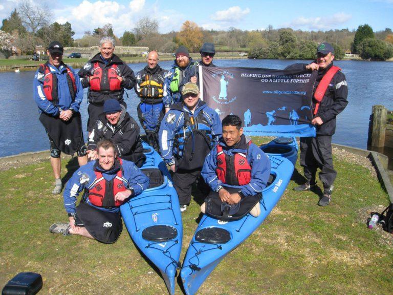 men and kayaks